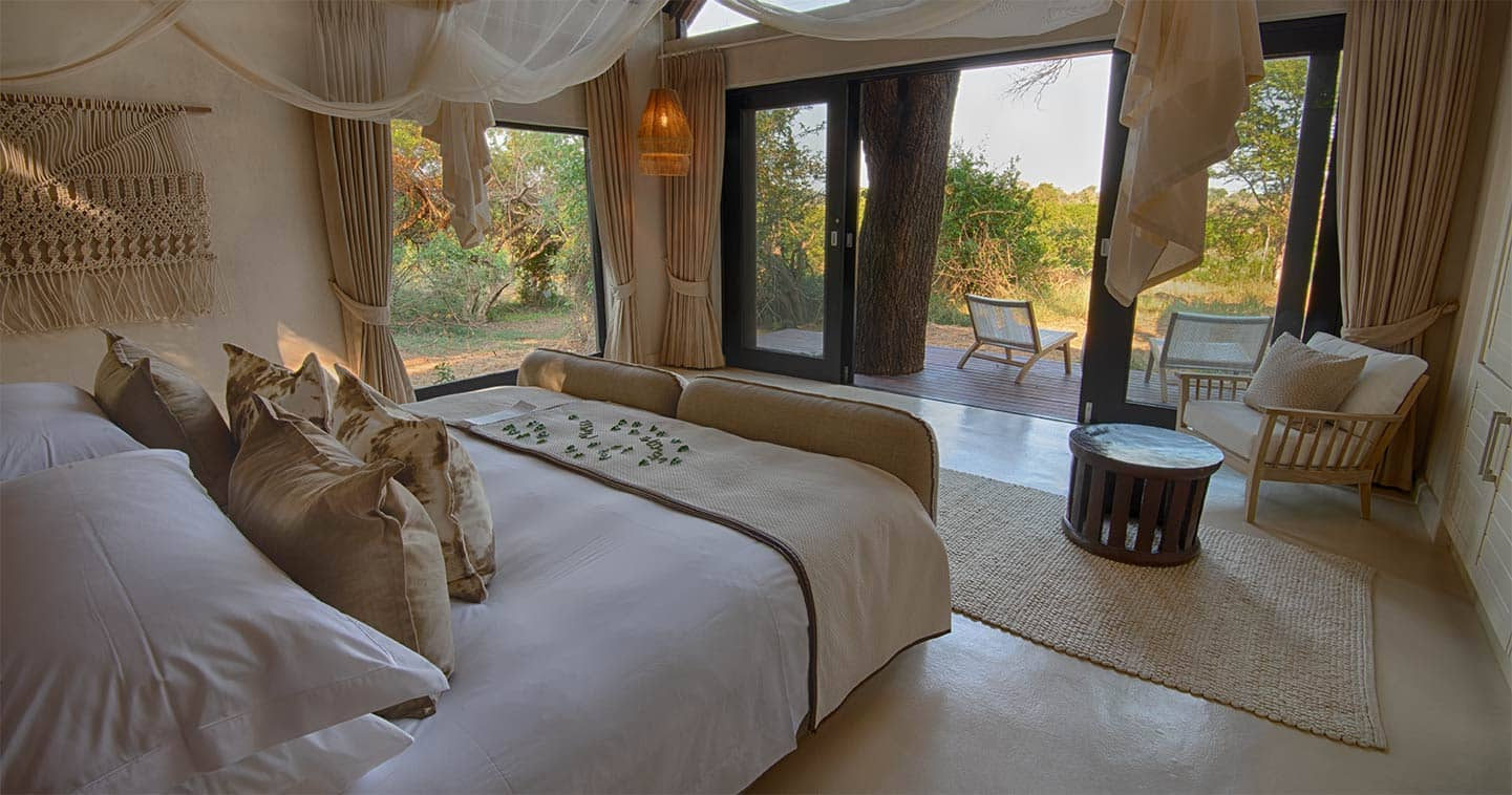 Lion Sands River Lodge bedroom in Sabi Sands