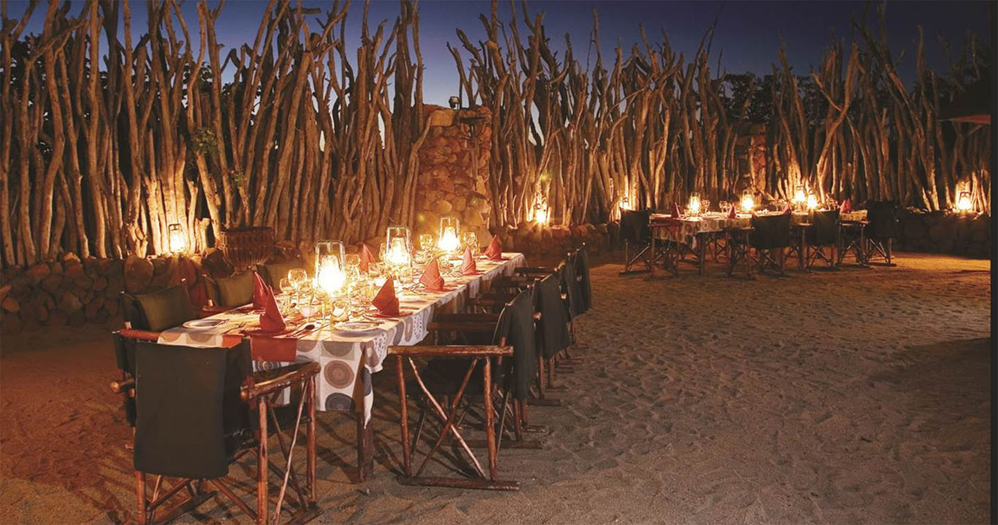 Enjoy a romantic dinner in the boma at Leopard Hills